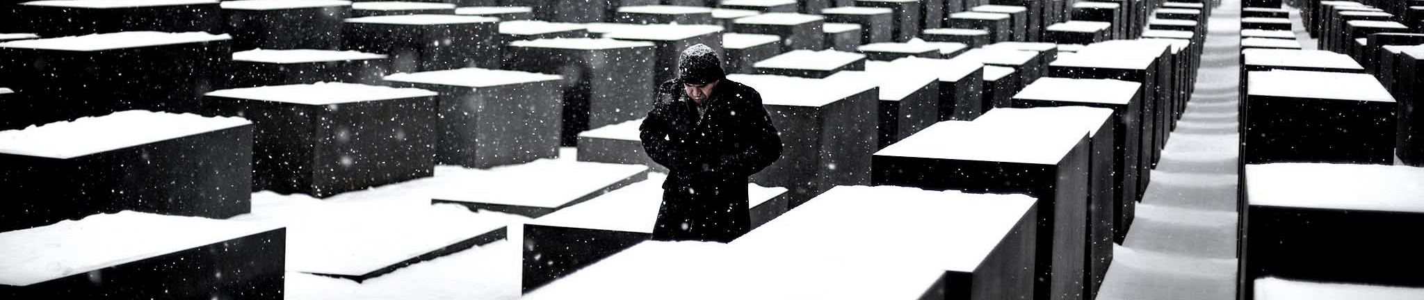 A man visits the snow covered Holocaust Memorial at the Internat